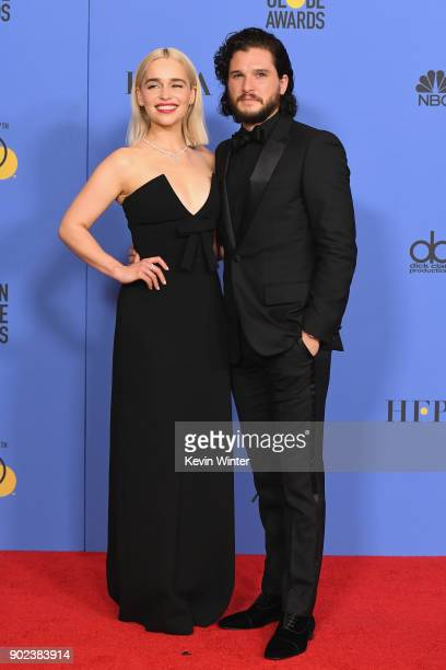 Actors Emilia Clarke and Kit Harington pose in the press room during The 75th Annual Golden Globe Awards at The Beverly Hilton Hotel on January 7...