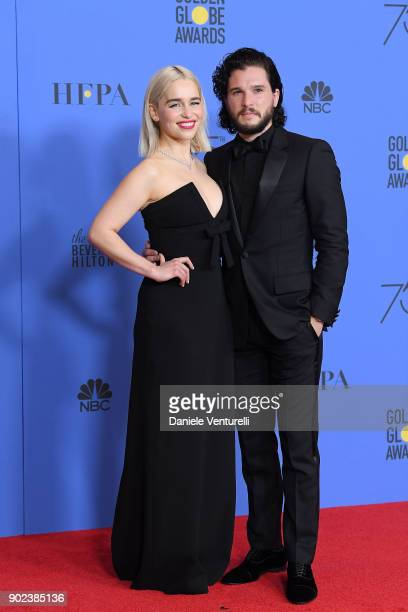 Actors Emilia Clarke and Kit Harington poses in the press room during the 75th Annual Golden Globe Awards at The Beverly Hilton Hotel on January 7...