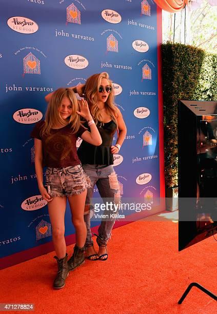 Actors Emily Alyn Lind and Natalie Alyn Lind attend Chrysler John Varvatos 12th Annual Stuart House Benefit at John Varvatos on April 26 2015 in Los...