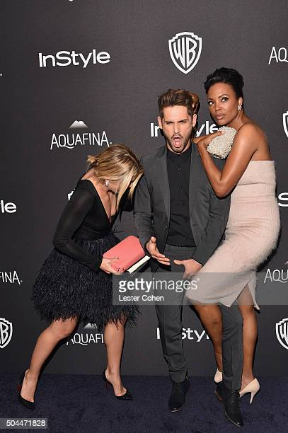 Actors Emily Bett Rickards JeanLuc Bilodeau and Aisha Tyler attend InStyle and Warner Bros 73rd Annual Golden Globe Awards PostParty at The Beverly...
