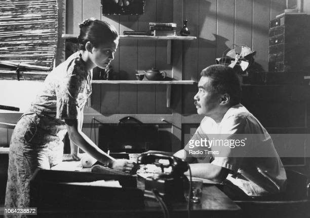 Actors Emily Bolton and Burt Kwouk in a scene from the television series 'Tenko' September 29th 1982