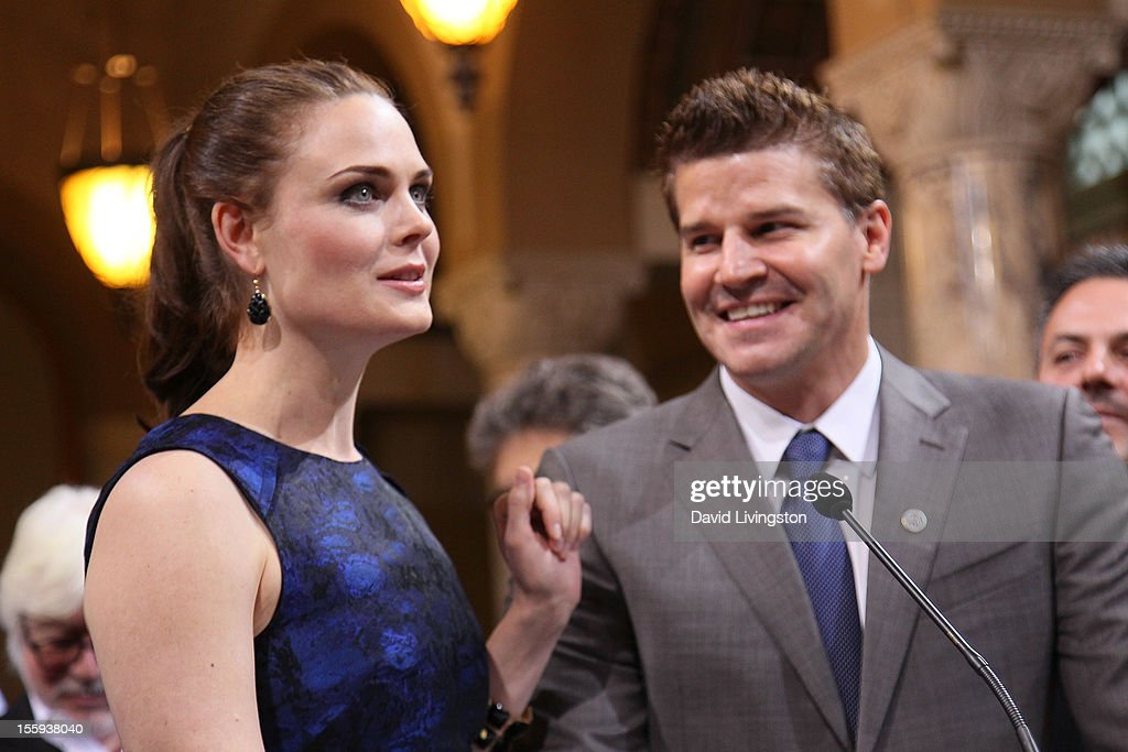 Actors Emily Deschanel (L) and David Boreanaz attend the LA City Council Chambers proclamation ceremony for Fox's 'Bones' at City Hall Council Chambers on November 9, 2012 in Los Angeles, California.