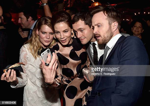 Actors Emma Greenwell Mcihelle Monaghan Hugh Dancy and Aaron Paul attend the after party for the premiere of Hulu's 'The Path' at ArcLight Hollywood...