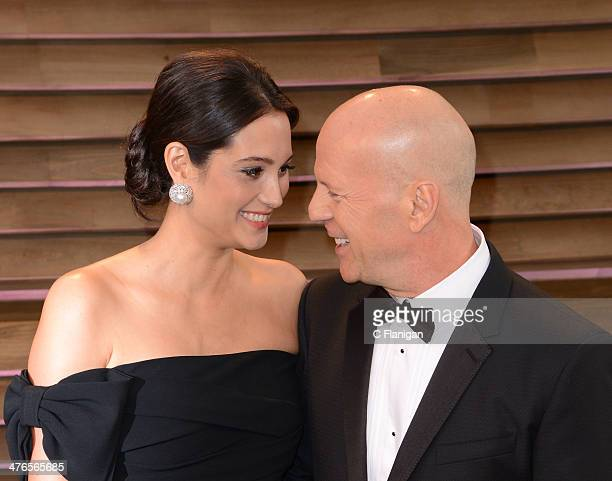 Actors Emma Heming and Bruce Willis arrive at the 2014 Vanity Fair Oscar Party Hosted By Graydon Carter on March 2 2014 in West Hollywood California