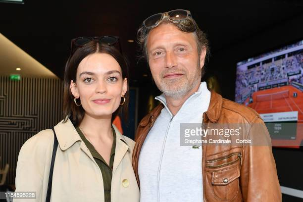 Actors Emma Mackey and Mads Mikkelsen attend the 2019 French Tennis Open Day Fourteen at Roland Garros on June 08 2019 in Paris France