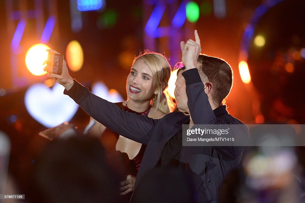 Actors Emma Roberts And Dave Franco Take A Selfie With A Fan Onstage