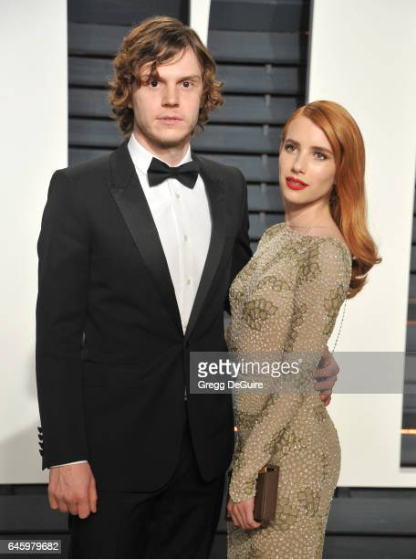 Actors Emma Roberts and Evan Peters arrive at the 2017 Vanity Fair Oscar Party Hosted By Graydon Carter at Wallis Annenberg Center for the Performing...