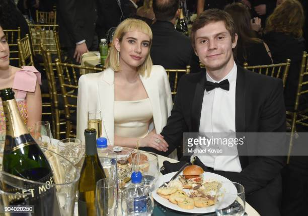 Actors Emma Roberts and Evan Peters attend Moet Chandon celebrate The 23rd Annual Critics' Choice Awards at Barker Hangar on January 11 2018 in Santa...