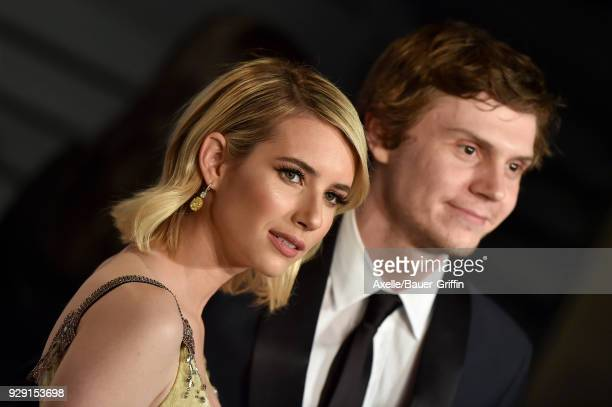 Actors Emma Roberts and Evan Peters attend the 2018 Vanity Fair Oscar Party hosted by Radhika Jones at Wallis Annenberg Center for the Performing...