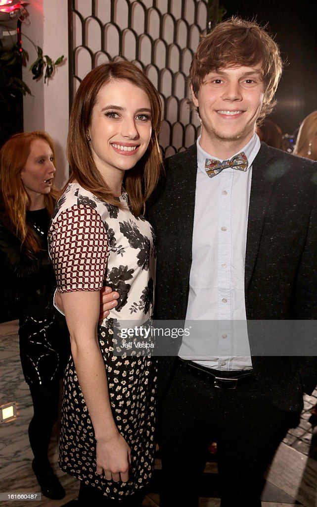 Actors Emma Roberts (L) and Evan Peters attend the Topshop Topman LA Opening Party at Cecconi's West Hollywood on February 13, 2013 in Los Angeles, California.