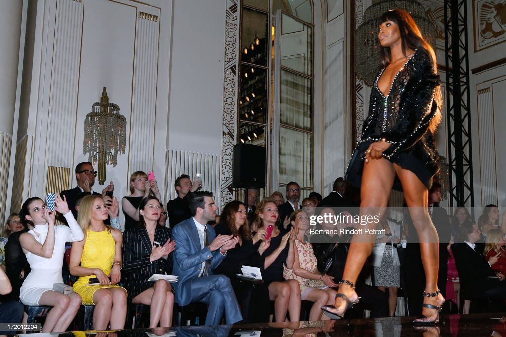 Actors Emma Roberts, Mena Suvari, Delphine Chaneac, Zachary Quinto, Guest, Thurman, Jo Levin and David Furnish watching model Naomi Campbell on the catwalk of the Versace show as part of Paris Fashion Week Haute-Couture Fall/Winter 2013-2014 at on June 30, 2013 in Paris, France.