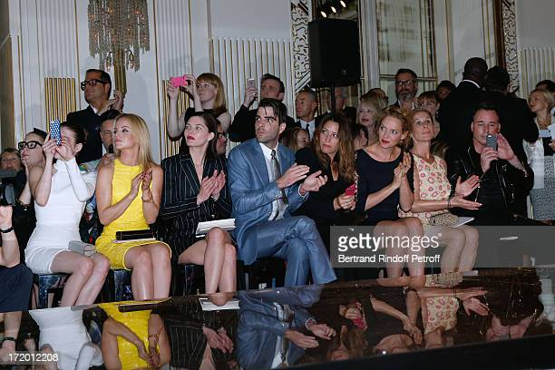 Actors Emma Roberts Mena Suvari Delphine Chaneac Zachary Quinto Guest Thurman Jo Levin and David Furnish attend the Versace show as part of Paris...