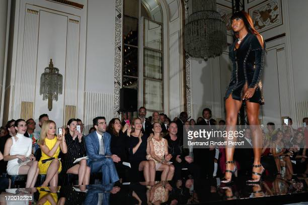 Actors Emma Roberts Mena Suvari Delphine Chaneac Zachary Quinto Guest Uma Thurman Jo Levin and David Furnish watching model Naomi Campbell on the...