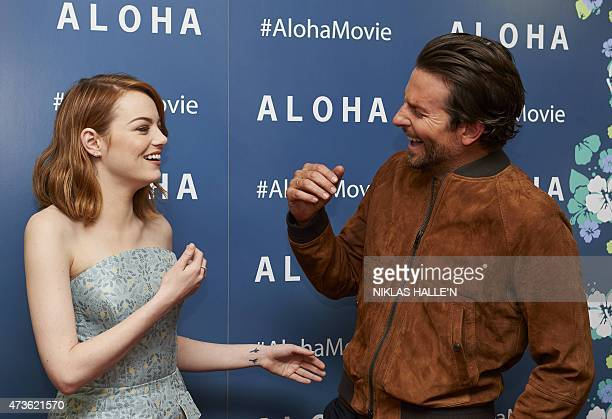 US actors Emma Stone and Bradley Cooper laugh together arriving to attend a special screening of the film Aloha in London on May 16 2015 AFP PHOTO /...