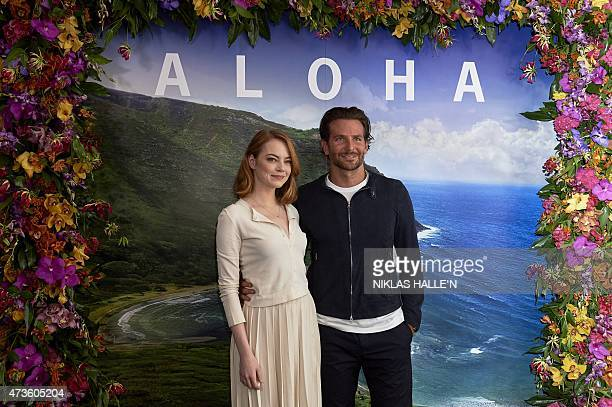 US actors Emma Stone and Bradley Cooper pose at a photocall for their new film release Aloha in London on May 16 2015 N