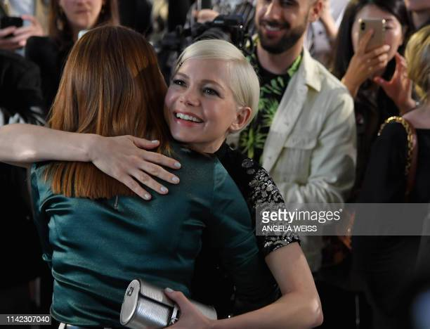 Actors Emma Stone and Michelle Williams attend the Louis Vuitton Cruise 2020 Fashion Show at TWA Flight Center at JFK Airport on May 8, 2019 in New...