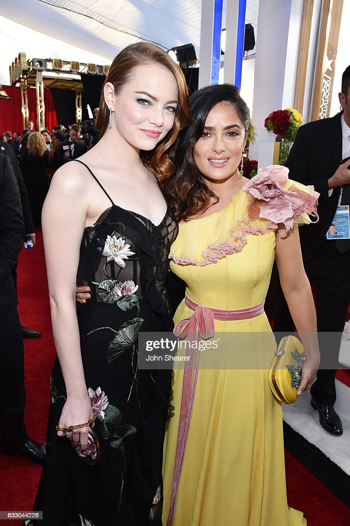 Actors Emma Stone (L) and Salma Hayek attend The 23rd Annual Screen Actors Guild Awards at The Shrine Auditorium on January 29, 2017 in Los Angeles, California.