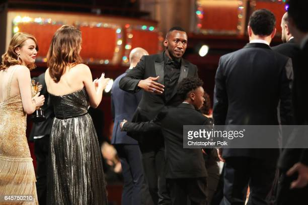 Actors Emma Stone Mahershala Ali and Alex R Hibbert celebrate the Best Picture award win for 'Moonlight' onstage during the 89th Annual Academy...