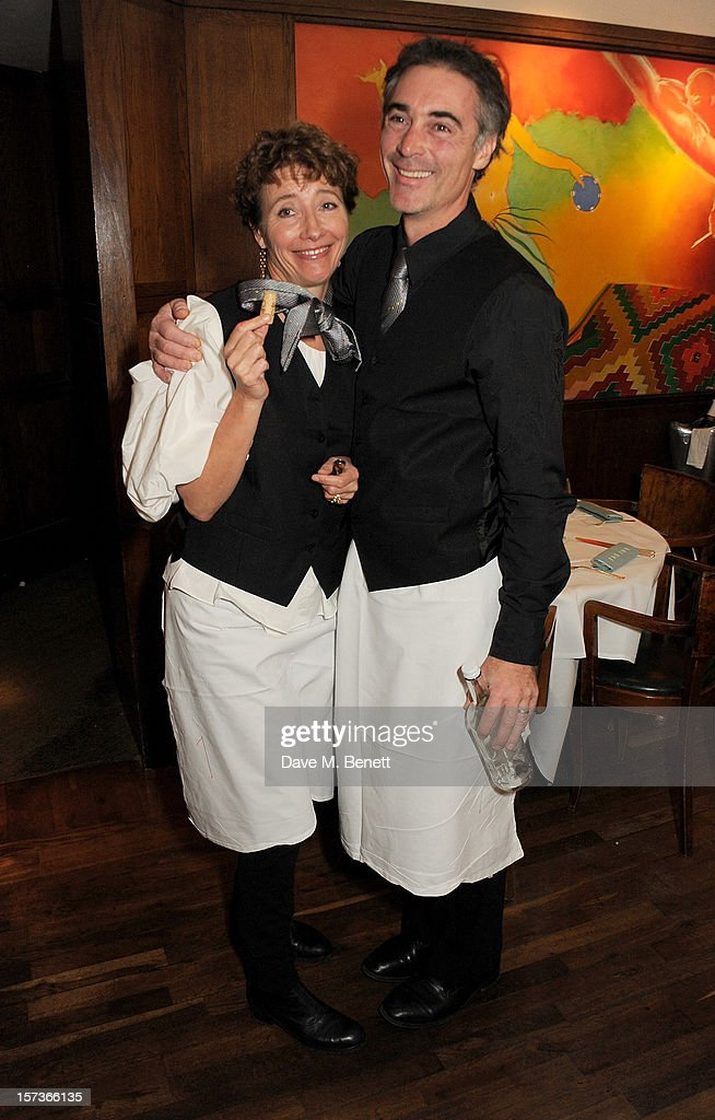 Actors Emma Thompson (L) and Greg Wise, working as waiters, attend One Night Only at The Ivy, featuring 30 stage and screen actors working as staff during dinner at The Ivy, in aid of The Combined Theatrical Charities, on December 2, 2012 in London, England.