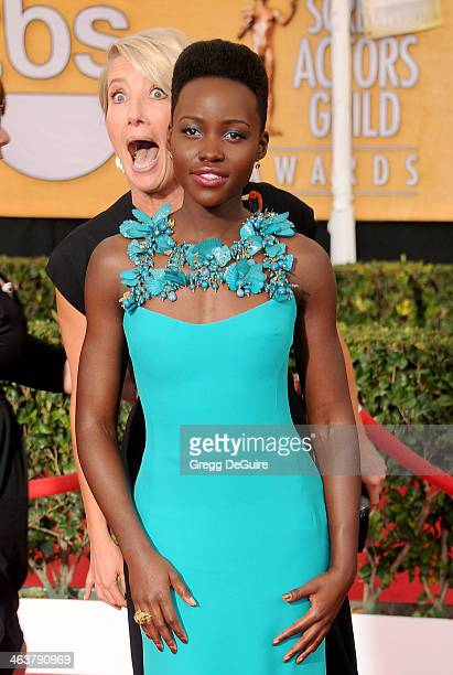 Actors Emma Thompson and Lupita Nyong'o arrive at the 20th Annual Screen Actors Guild Awards at The Shrine Auditorium on January 18, 2014 in Los...