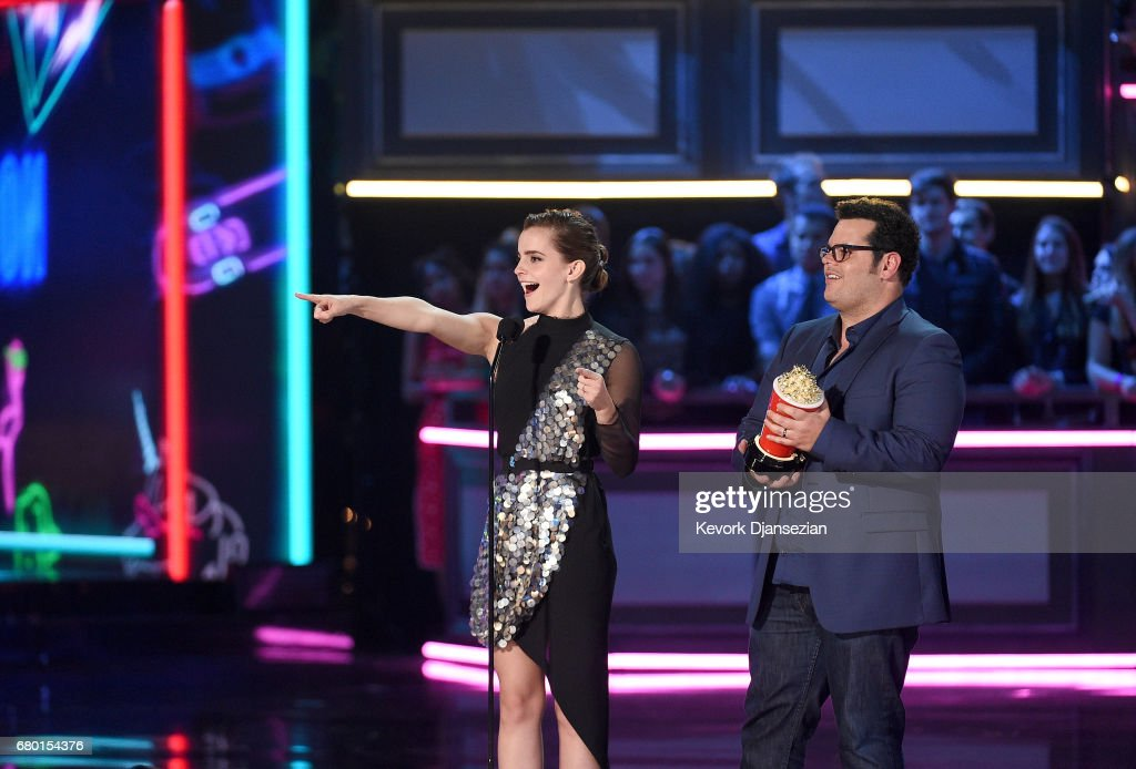 Actors Emma Watson and Josh Gad accept the Movie of the Year award for 'Beauty and the Beast' onstage during the 2017 MTV Movie And TV Awards at The Shrine Auditorium on May 7, 2017 in Los Angeles, California.