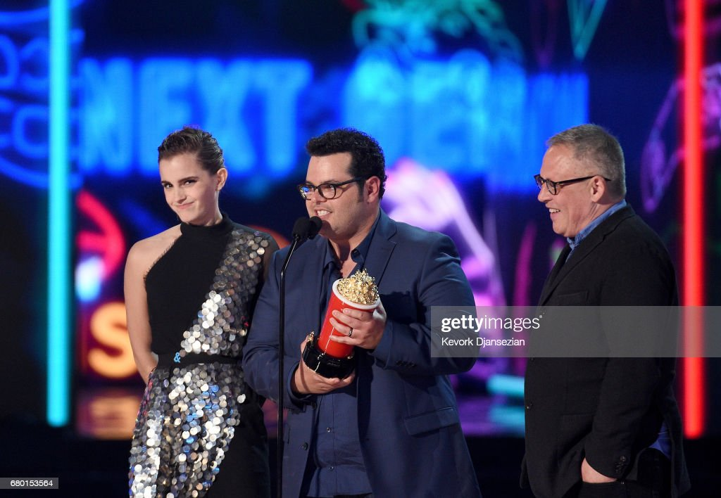 Actors Emma Watson and Josh Gad and director Bill Condon onstage during the 2017 MTV Movie And TV Awards at The Shrine Auditorium on May 7, 2017 in Los Angeles, California.