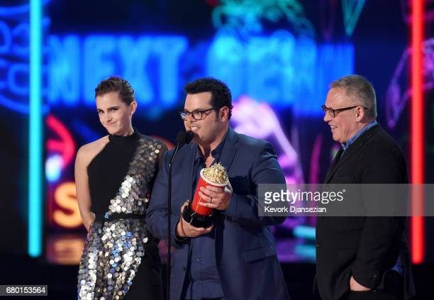 Actors Emma Watson and Josh Gad and director Bill Condon onstage during the 2017 MTV Movie And TV Awards at The Shrine Auditorium on May 7 2017 in...