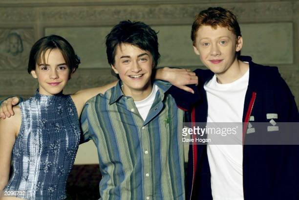 Actors Emma Watson Daniel Radcliffe and Rupert Grint attend a photocall for the movie 'Harry Potter and the Chamber of Secrets' at the Guildhall...
