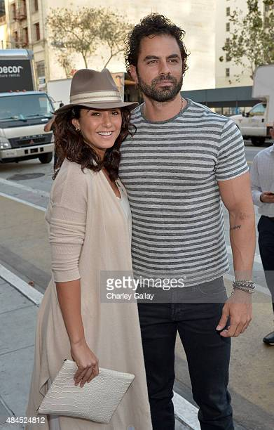 """Actors Emmanuelle Chriqui and Adrian Bellani attend the Amazon premiere screening for original drama series """"Hand Of God"""" at The Theatre at Ace Hotel..."""