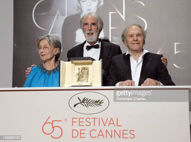 Actors Emmanuelle Riva JeanLouis Trintignant and director Michael Haneke pose with the Palme DOr for 'Amour' at the Winners Photocall during the 65th...