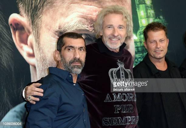 Actors Erdal Yildiz Thomas Gottschalk and Til Schweiger arrive to the premiere of the film 'Der grosse Schmerz' from the TV series 'Tatort' in Berlin...