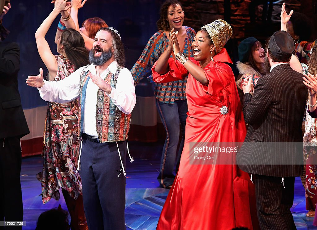 Actors Eric Anderson and Amber Iman participate in the curtain call for the Broadway opening night of 'Soul Doctor' at the Circle in the Square Theatre on August 15, 2013 in New York City.