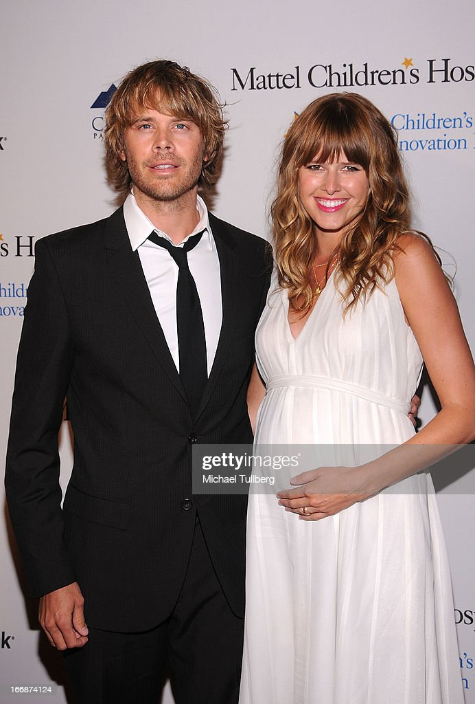 Actors Eric Christian Olsen and Sarah Wright attend 'The Kaleidescope Ball' benefitting The UCLA Children's Discovery And Innovation at Beverly Hills Hotel on April 17, 2013 in Beverly Hills, California.