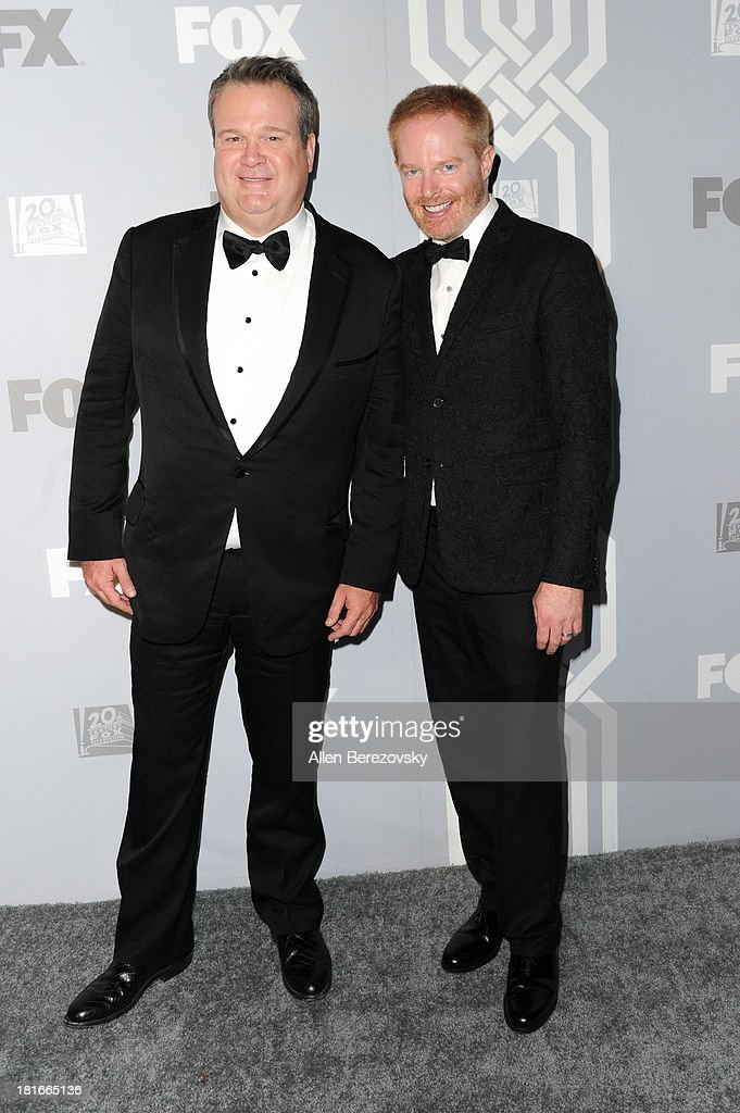 Actors Eric Stonestreet (L) and Jesse Tyler Ferguson attend the Fox Broadcasting, Twentieth Century Fox Television and FX 2013 Emmy nominees celebration at Soleto on September 22, 2013 in Los Angeles, California.