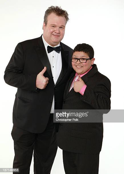 Actors Eric Stonestreet and Rico Rodriguez winners of the Best Television Series Musical or Comedy award for 'Modern Family' pose for a portrait...