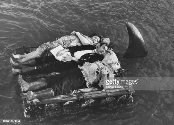 Actors Eric Sykes and Hattie Jacques on a life raft in the sea in a scene from episode 'Shipwreck' of the television sitcom 'Sykes and a Big Big...
