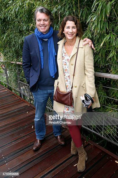 Actors Eric Viellard and Isabelle Gelinas attend the 2015 Roland Garros French Tennis Open - Day Eight, on May 31, 2015 in Paris, France.