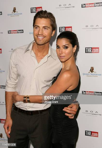 Actors Eric Winter and Roselyn Sanchez arrive at Hollywood Reporter's philanthropist of the year award reception held at BOA Sunset on November 16...
