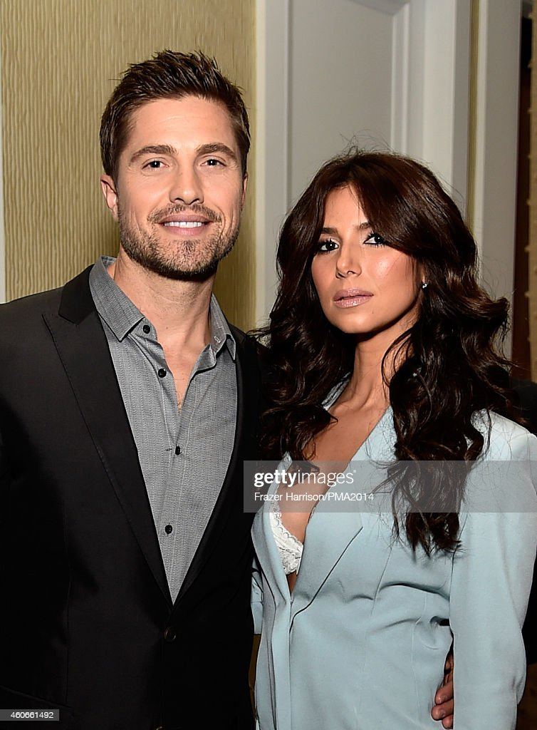 Actors Eric Winter (L) and Roselyn Sanchez attend the PEOPLE Magazine Awards at The Beverly Hilton Hotel on December 18, 2014 in Beverly Hills, California.