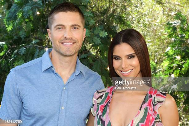 Actors Eric Winter and Roselyn Sanchez visit Hallmark's Home Family at Universal Studios Hollywood on July 31 2019 in Universal City California