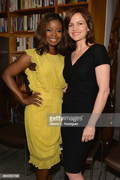 Actors Erica Tazel and Carla Gugino attend the Writers Bloc Presents A Tribute to Elmore Leonard on January 21 2014 in Santa Monica California