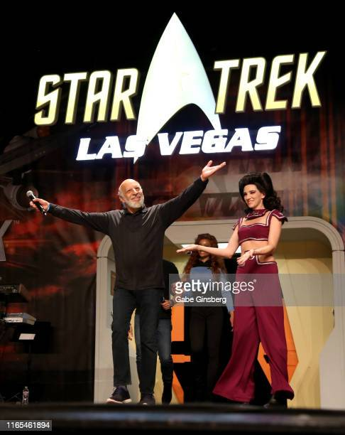 Actors Erick Avari is escorted on stage by cosplay model Stefany Rose during the Deep Space Nine panel at the 18th annual Official Star Trek...