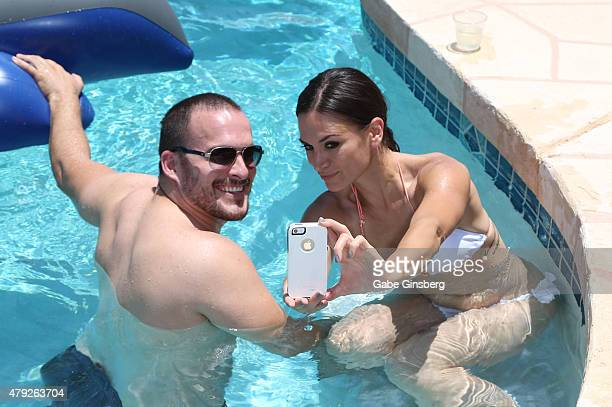 Actors Erik Aude and Erin O'Brien take a selfie as they attend a birthday party for former Major League Baseball player Jose Canseco on July 2 2015...