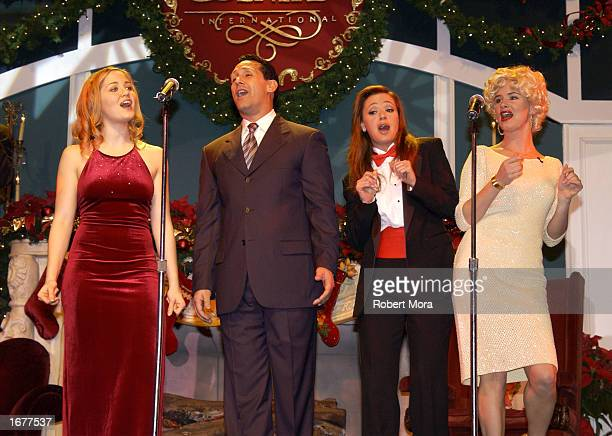 Actors Erika Christensen Leah Remini and Juliette Lewis perform on stage at the Church of Scientology's fundraiser Christmas Stories X to benefit the...