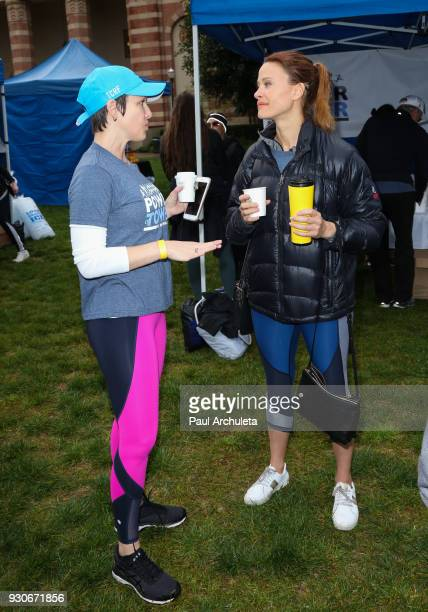 Actors Erin Cummings and Scottie Thompson attend the 'Power Of Tower' run/walk at UCLA on March 11 2018 in Los Angeles California