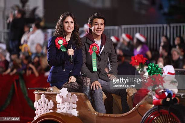 Actors Erin Sanders and Ryan Potter ride in the 80th Anniversary Hollywood Christmas Parade on November 27 2011 in Hollywood California