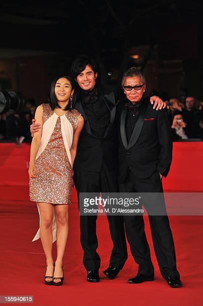 Actors Erina Mizuno Hideaki Ito and director Takashi Miike attend the Aku No Kyoten Premiere during the 7th Rome Film Festival at the Auditorium...
