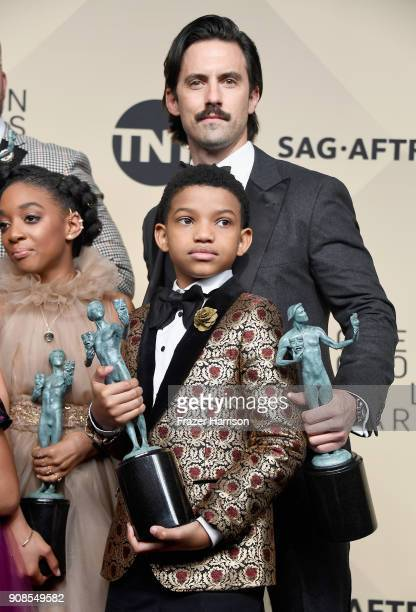 Actors Eris Baker Lonnie Chavis and Milo Ventimiglia winners of Outstanding Performance by an Ensemble in a Drama Series for 'This Is Us' pose in the...