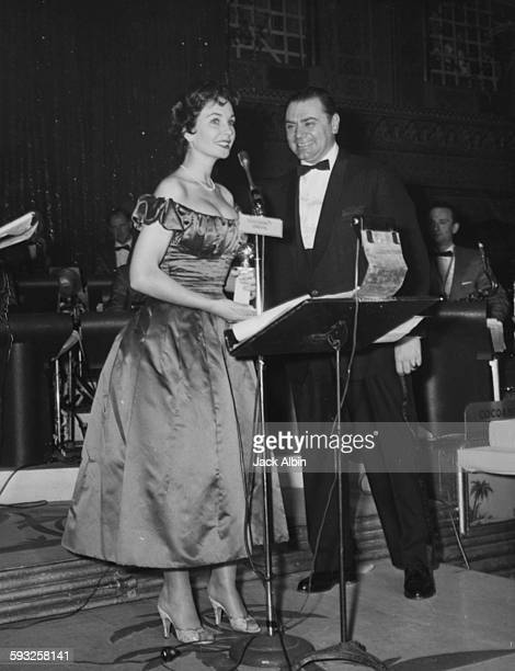 Actors Ernest Borgnine and Jean Simmons on stage receiving their acting awards at the Foreign Press Awards or Golden Globes in Hollywood 1956