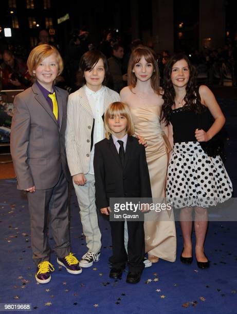 Actors Eros Valhos Asa Butterfield Rosie Taylor Ritson Lil Woods and Oscar Steer attend the 'Nanny McPhee And The Big Bang' world film premiere at...